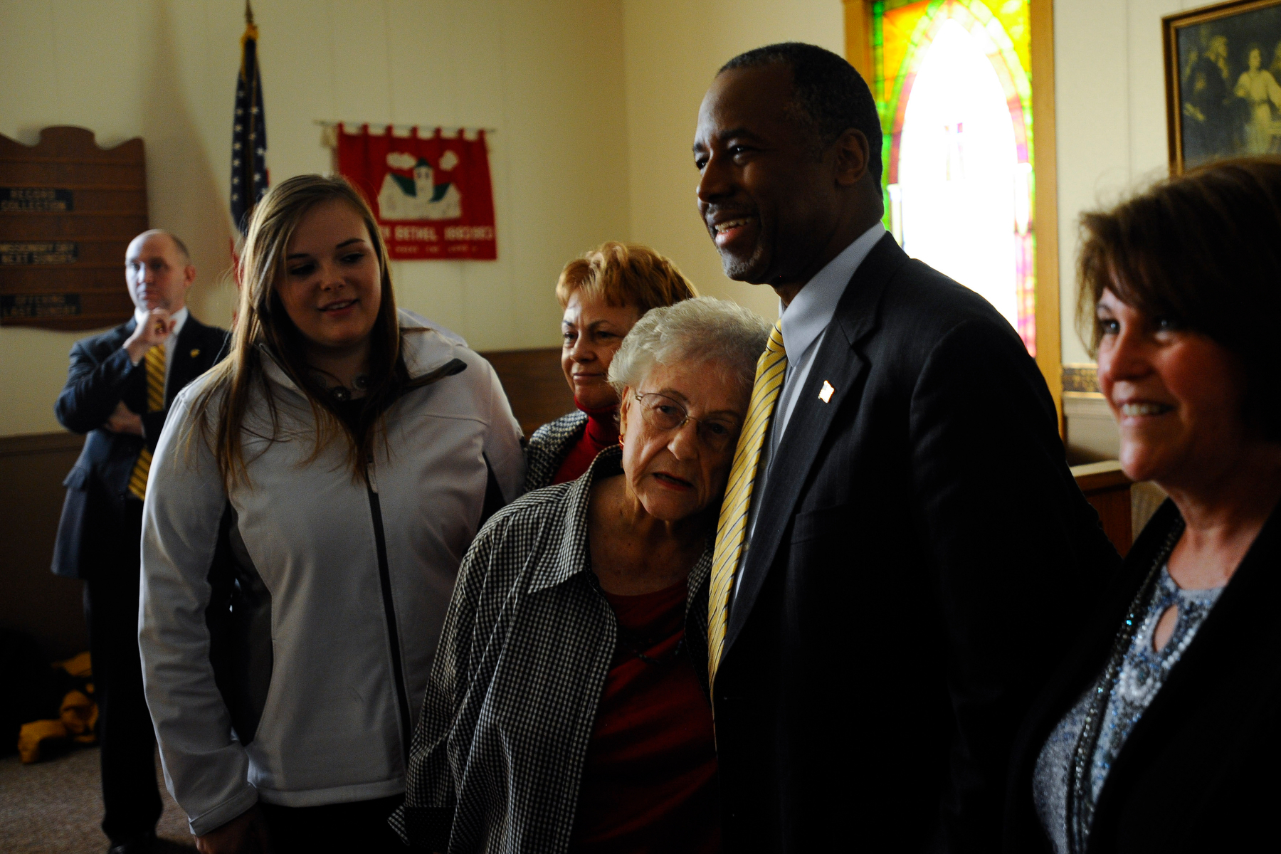 Laurale Hunter lays her head on the chest of U.S. Republican presidential candidate Ben Carson at South Bethel Church in Tipton, Iowa November 22, 2015. REUTERS/Mark Kauzlarich
