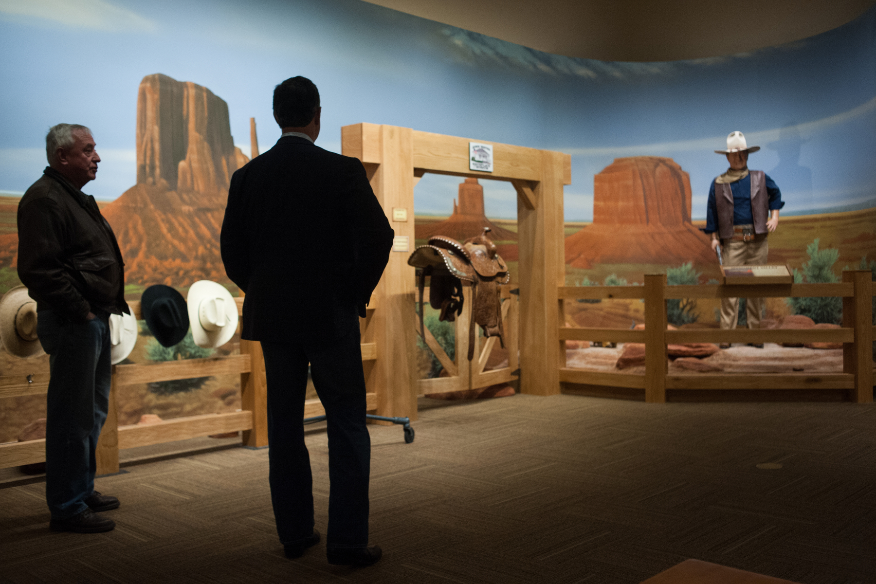 """U.S. Republican presidential candidate Rick Santorum tours the new John Wayne Museum in Winterset, Iowa December 8, 2015. Santorum toured the old museum last election cycle but took 20 minutes to tour the new facility and stumbled into the theatre while John Wayne's character from """"The Alamo"""" spoke on the power of the word """"republic""""."""