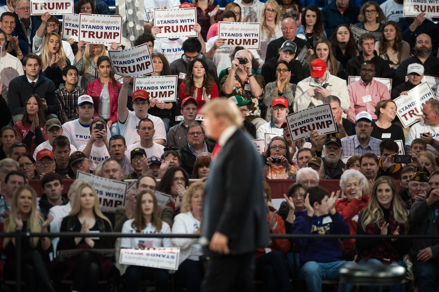 Attendees watch as Donald Trump, president and chief executive of Trump Organization Inc. and 2016 Republican presidential candidate, speaks during a campaign event in Des Moines, Iowa, U.S., on Friday, Dec. 11, 2015. Mark Kauzlarich/Bloomberg
