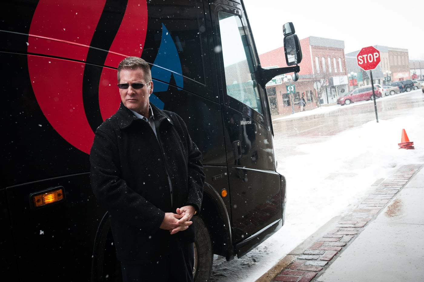 Retired United States Secret Service Special Agent Brian Hunter, a private security contractor for U.S. Republican presidential candidate Ted Cruz, stands outside the campaign bus ahead of a stop at Lantern Coffeehouse in Sibley, Iowa January 6, 2016.