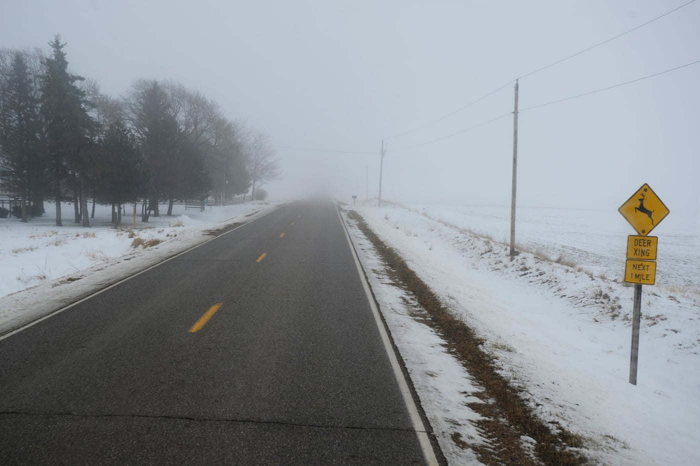 Fog covers the road between Storm Lake, Iowa and Pocahontas, Iowa where U.S. Republican presidential candidate Ted Cruz will hold his first campaign event of the fourth day of his bus tour through Iowa January 7, 2016.