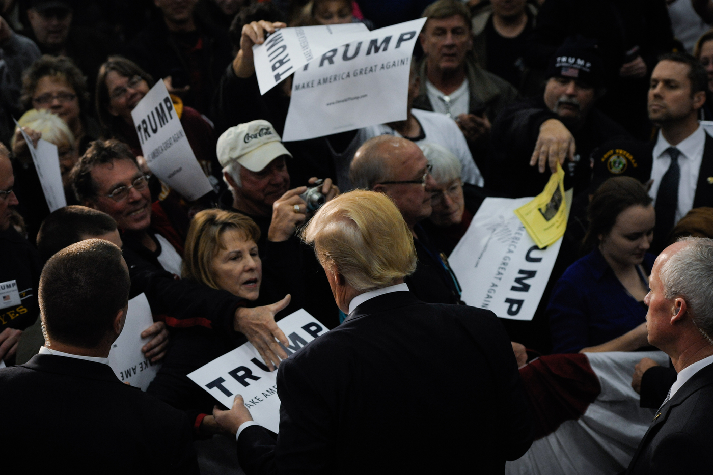 A supporter of Republican U.S. presidential candidate Donald Trump reaches out for a handshake after a rally in Spencer, Iowa on December 5, 2015.