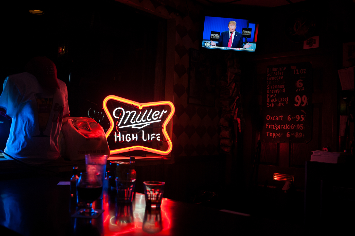 Republican U.S. presidential candidate Donald Trump is seen on TV at the High Life Lounge in Des Moines, Iowa as he participates in the the Republican debate on FOX Business network in Columbia, South Carolina on January 14, 2016.