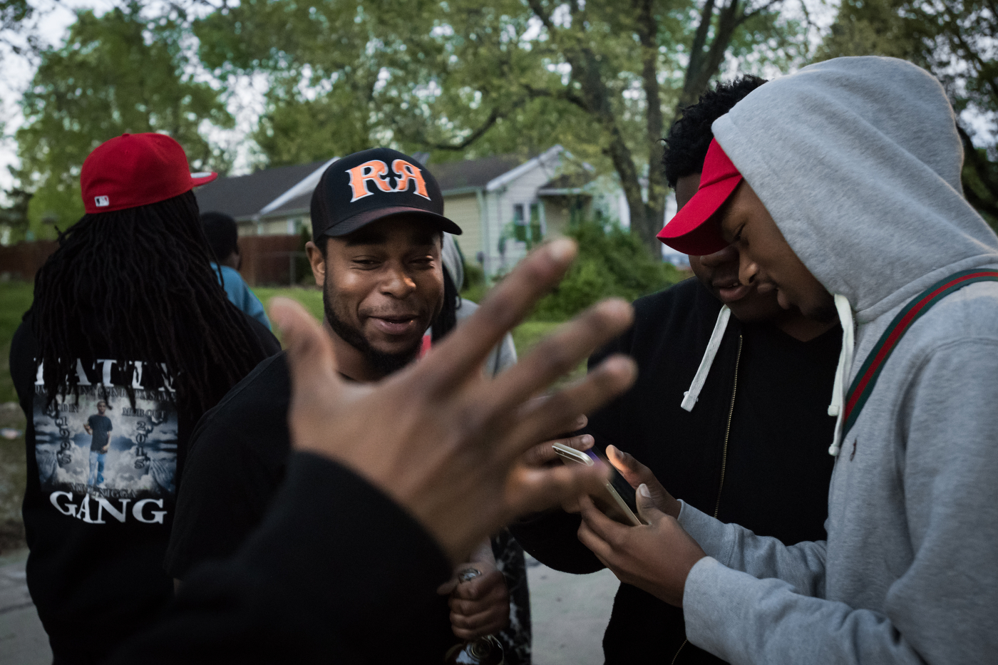 """Meech greets a friend while hanging out in the Bermuda neighborhood of Ferguson, Mo. Their group calls themselves Fatty Gang, named after their friend, 20 year-old Antwon """"Fatty"""" Smith, who was shot to death in February, 2015."""