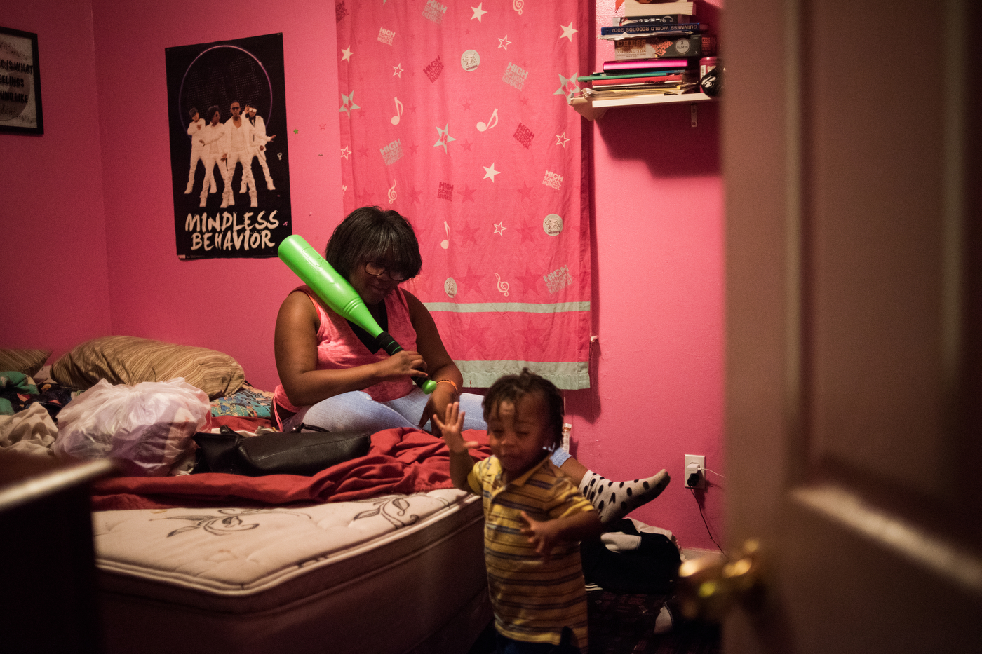 """Davyin Morris, 2, plays with his aunt Abreyale Carter, 11, in the Carter family home. Morris' mom told him to go fight Abreyale after she took one of his Capri Sun packs, saying """"I told you, if someone takes something of yours, you have to fight them."""