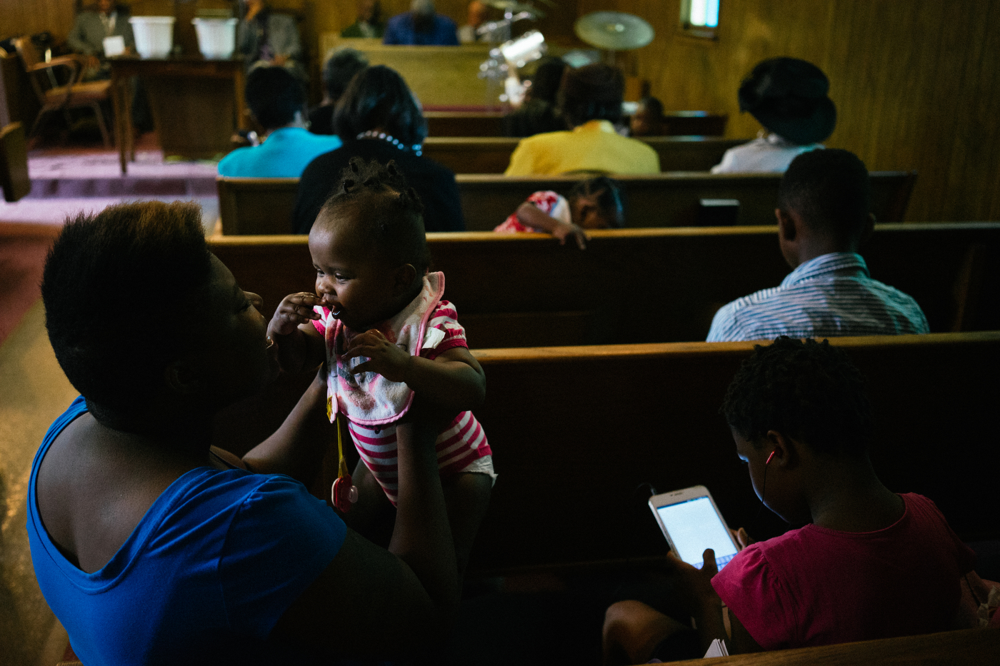 A woman plays with her granddaughter during Sunday worship in Ferguson.