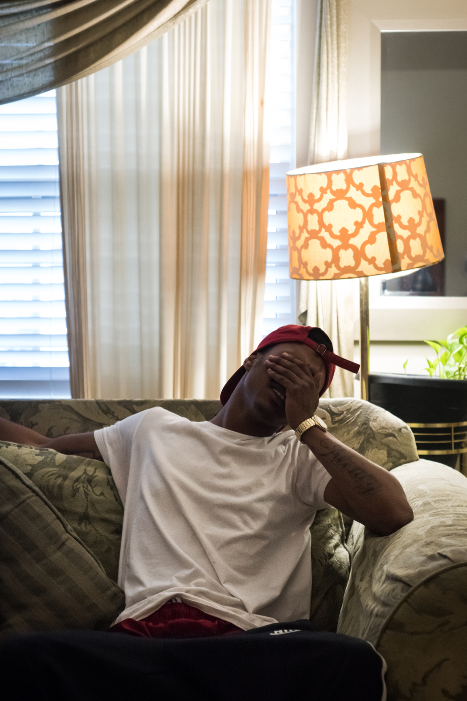 TJ Banks laughs at a joke in a friend's mother's condo in Ferguson.