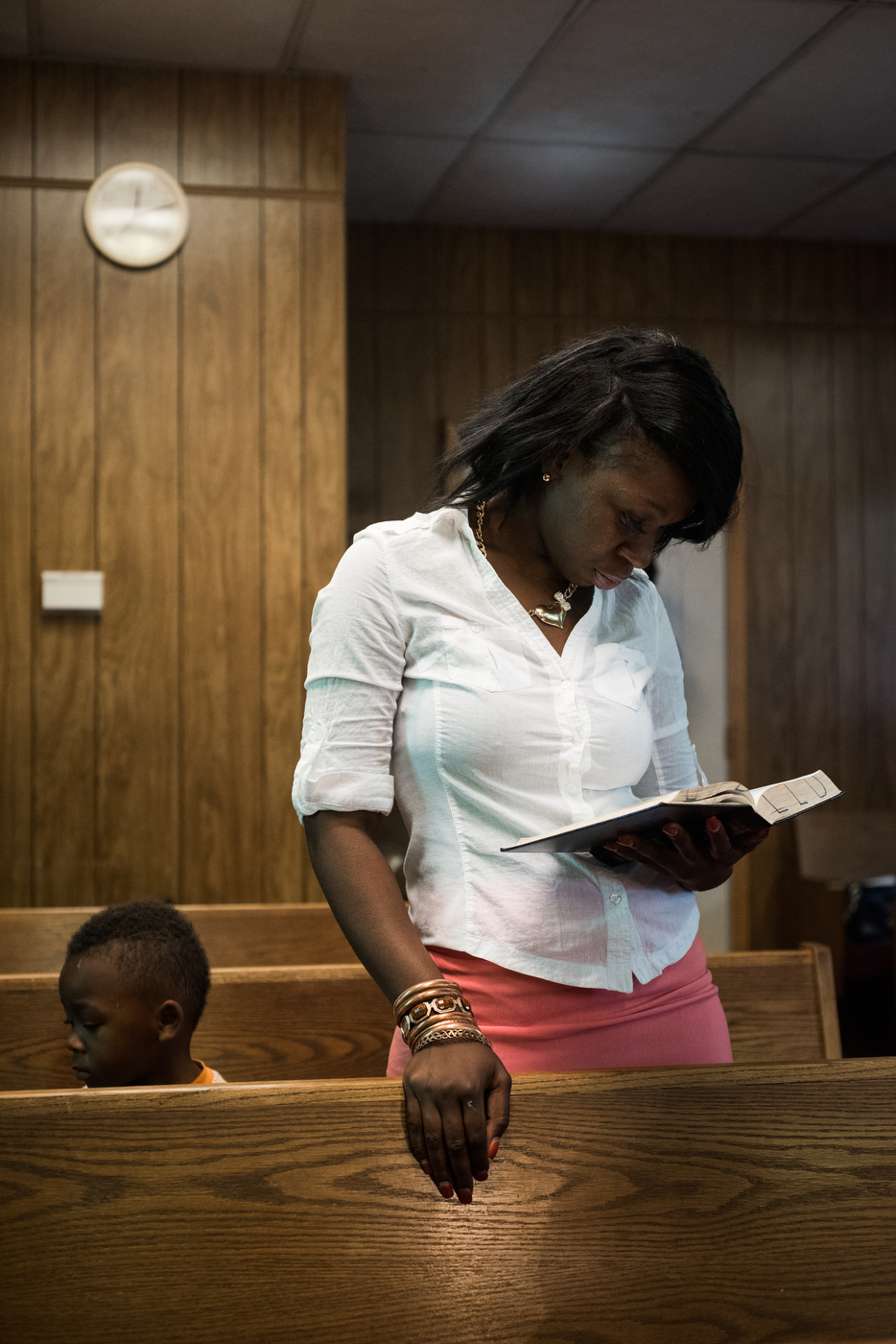Latonya Williams and her son Carlos Williams attend worship at the Christ Love Divine Missionary Baptist Church in Ferguson, Mo.