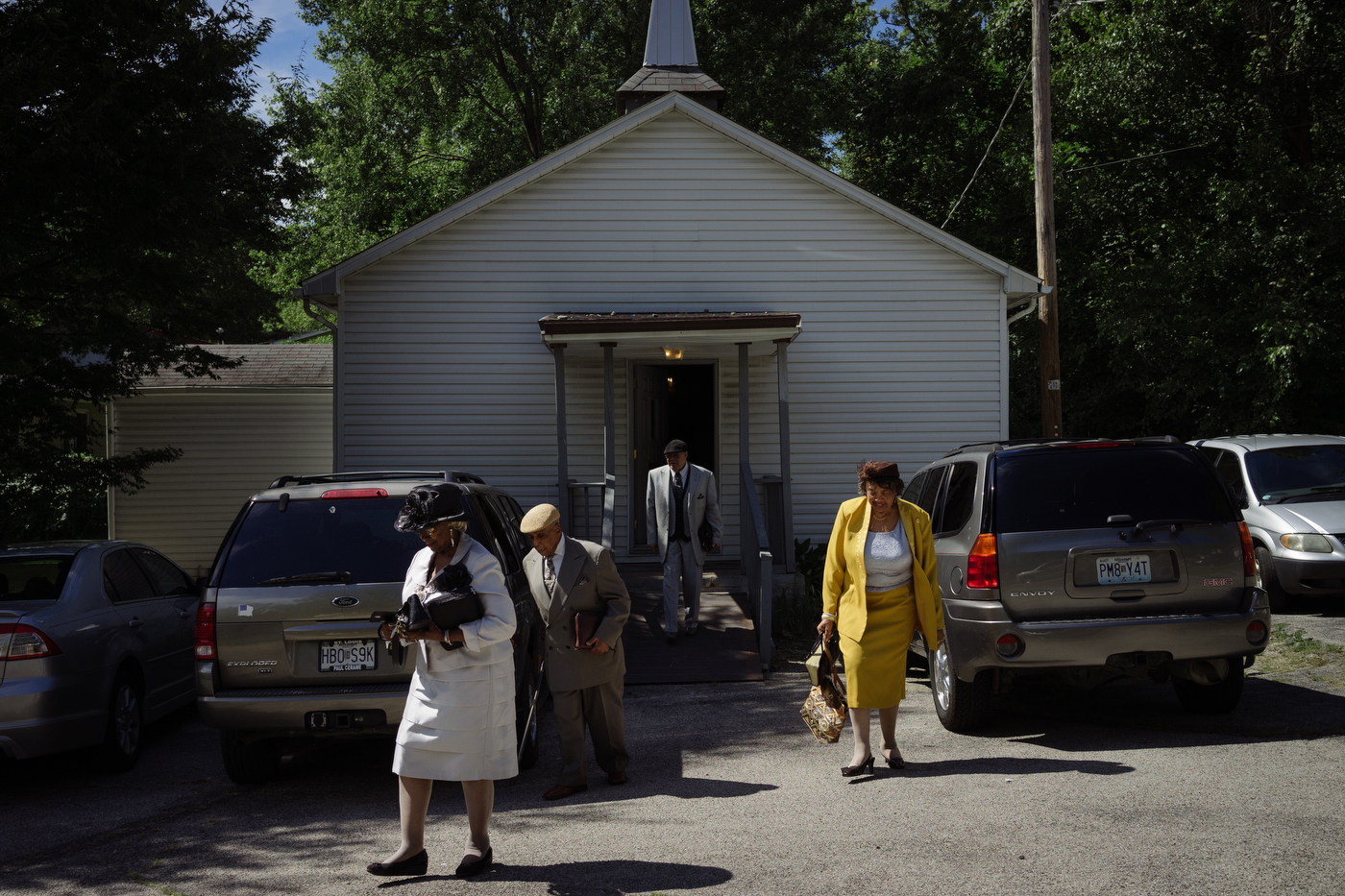 Parishioners leave Christ Love Divine Missionary Baptist Church after Sunday worship. When the congregation bought the building 35 years ago from the original owners, a white church, they marched down the street to celebrate their first service; someone in the (then predominately white) neighborhood called the police in confusion.