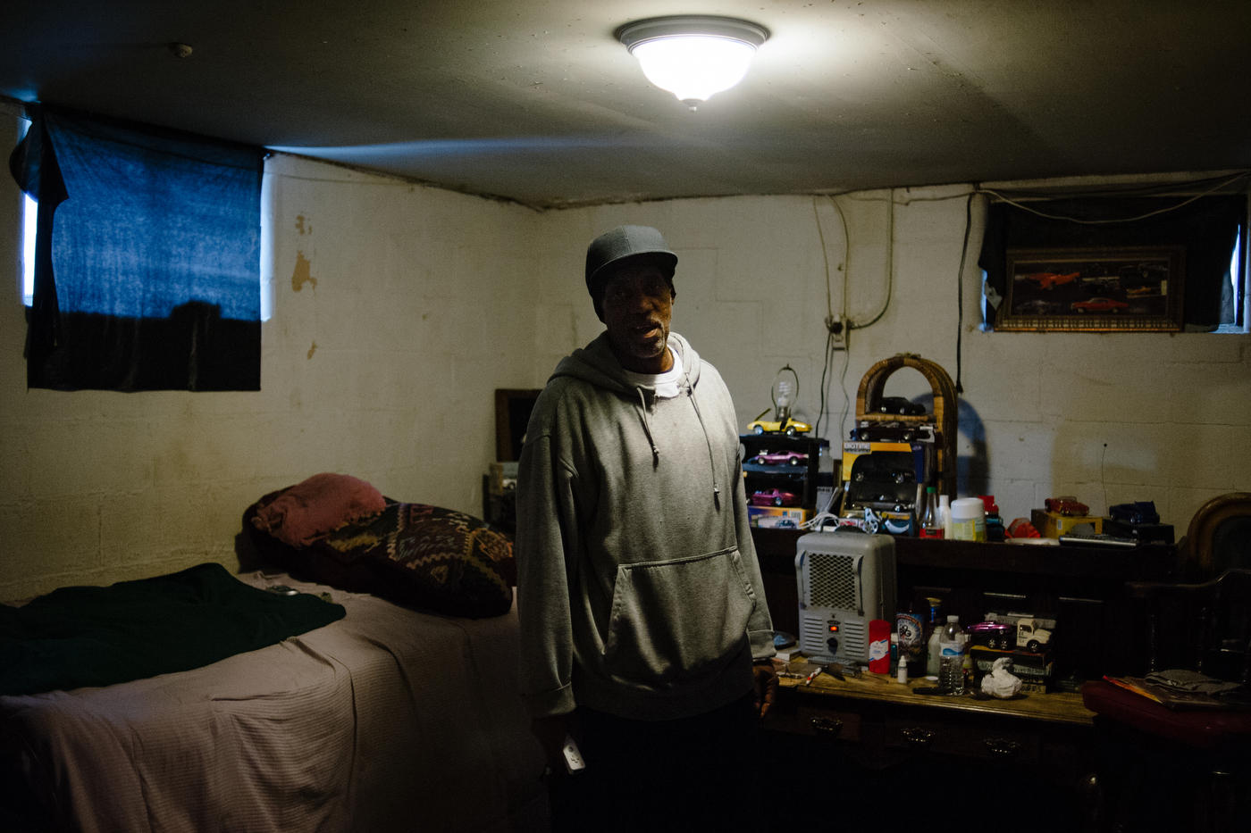 """""""My Wii and my model cars. That's what keeps me off the streets,"""" says Earl Carter in the basement of his home in Ferguson, MO. Formerly addicted to crack, Carter was honorably discharged from the Air Force but has been arrested over 20 times for traffic violations and is currently suing the city over their de facto debtors prisons."""