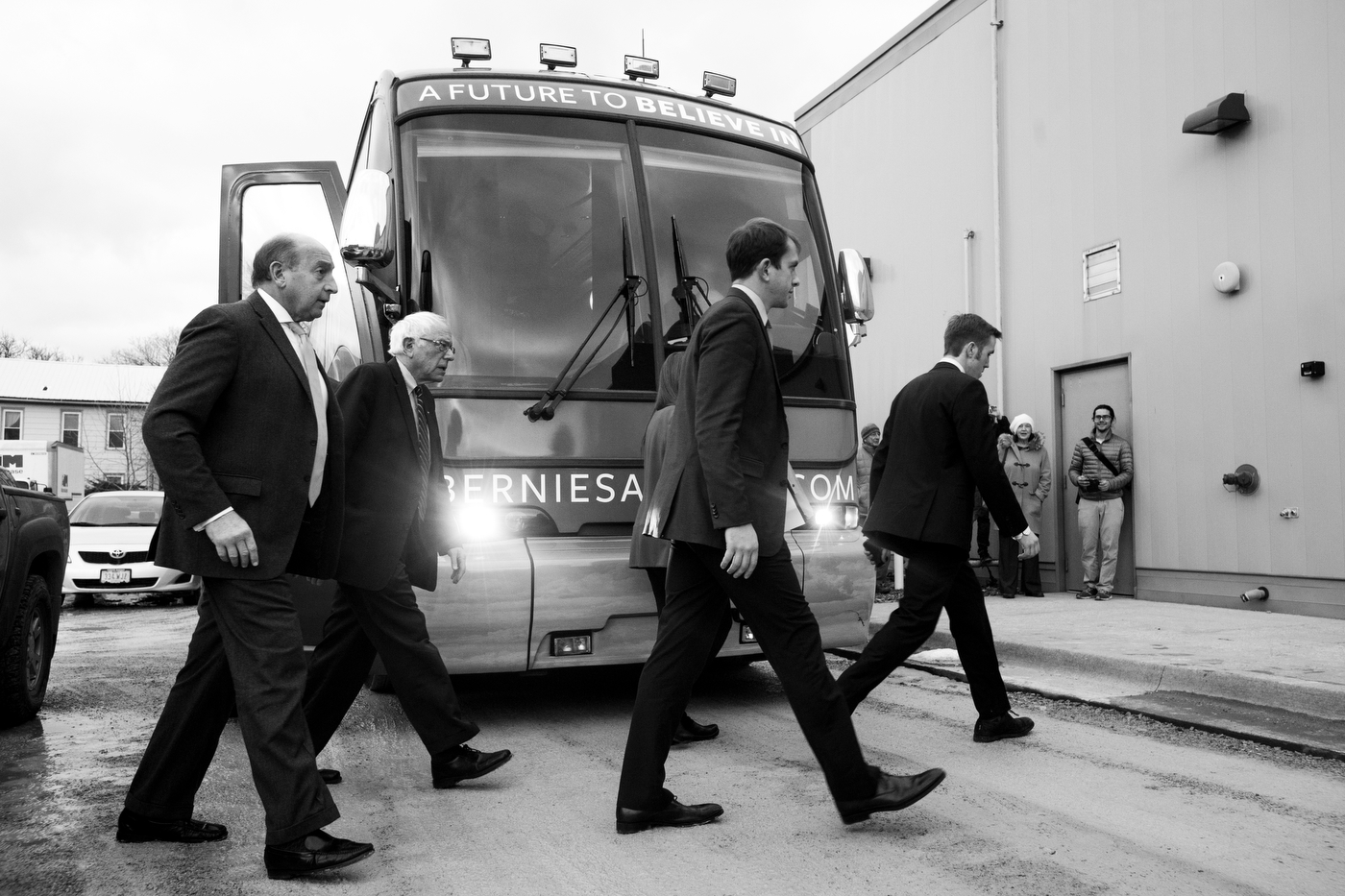 Democratic presidential candidate Bernie Sanders arrives with staff at a rally in Fairfield, Iowa on January 28, four days before the Iowa caucuses.
