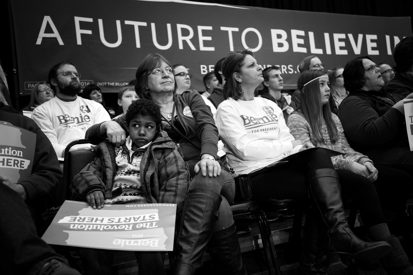 Lonnie McAllister and her grandson Vincent McAllister, 9, listen as Democratic presidential candidate Bernie Sanders speaks at a town hall in Independence, Iowa on January 24.