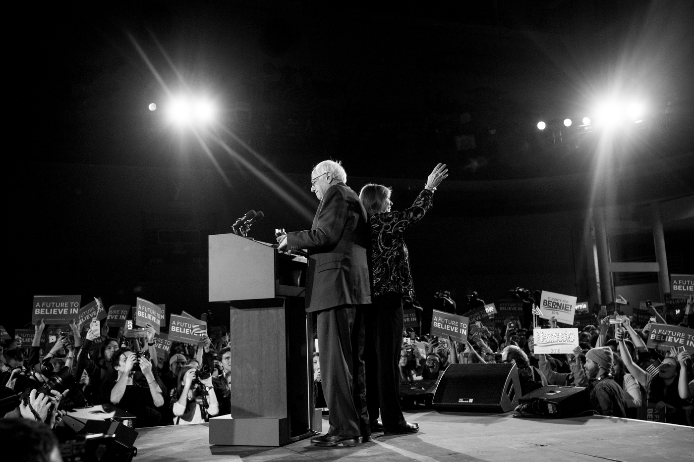 Democratic presidential candidate Bernie Sanders takes the stage as his wife Jane waves to the crowd at a campaign rally and concert at the University of Iowa in Iowa City, Iowa on January 30. Almost 4,000 attended the rally, where bands Foster the People and Vampire Weekend opened, but Bernie Sanders drew the most applause.