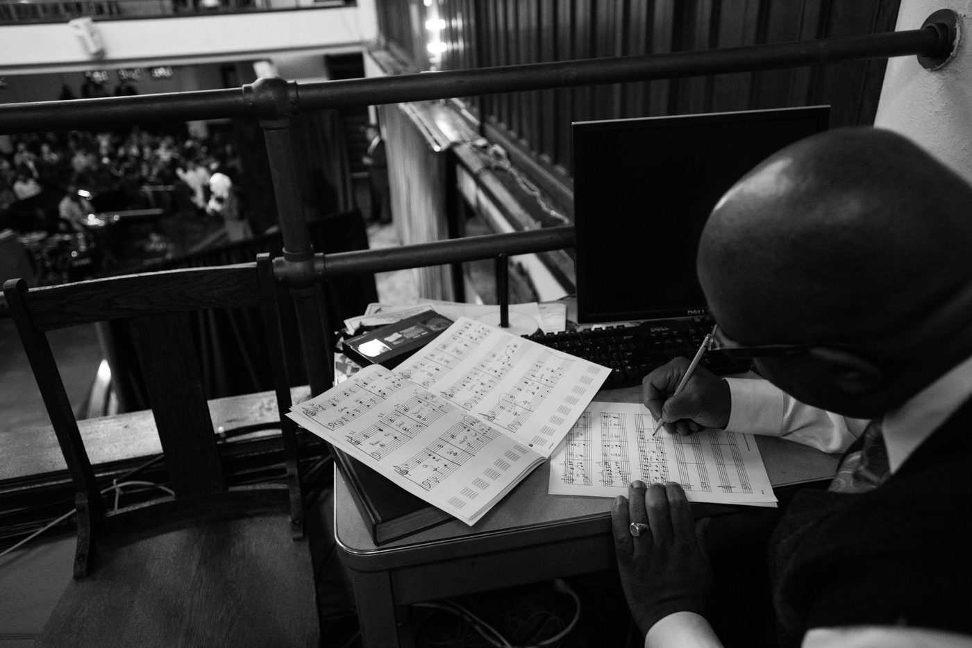 Theodore Thomas Jr., organist at Tindley Temple United Methodist Church, does arrangements as Democratic presidential candidate Bernie Sanders speaks at an African American Community Conversation town hall event in Philadelphia, Pennsylvania on April 6.