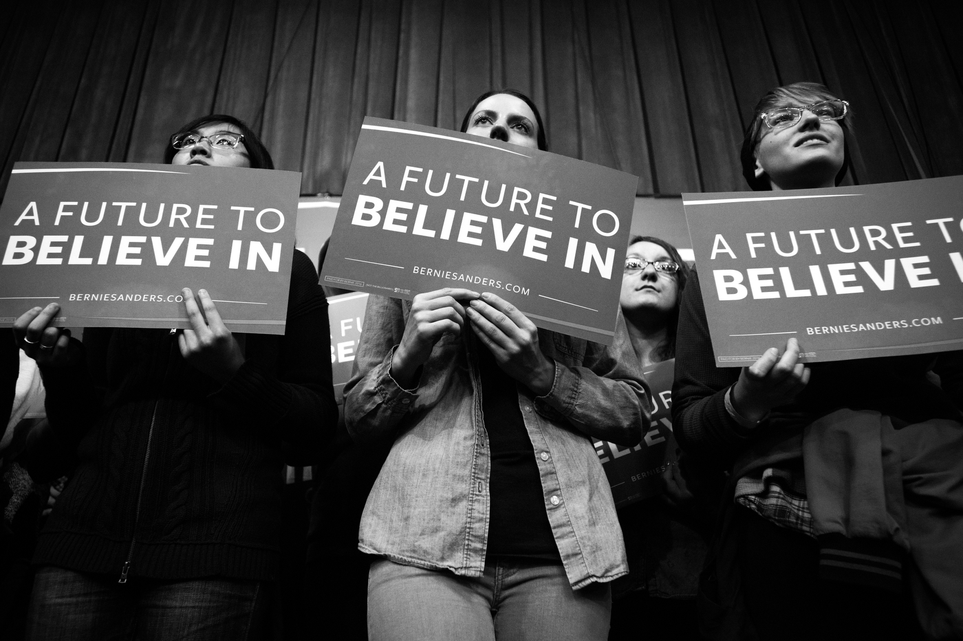 Supporters of Democratic presidential candidate Bernie Sanders listens as he speaks at the University of Wisconsin-Eau Claire in Eau Claire, Wisconsin on April 2.