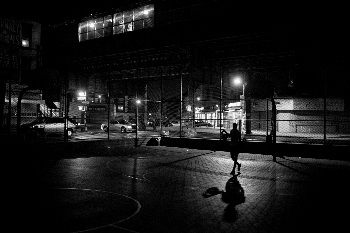 Zayan, 14, plays basketball alone well after the close of the public playground near the Kosciuzko J train stop in Bushwick, NY. Zayan grew up in this neighborhood.