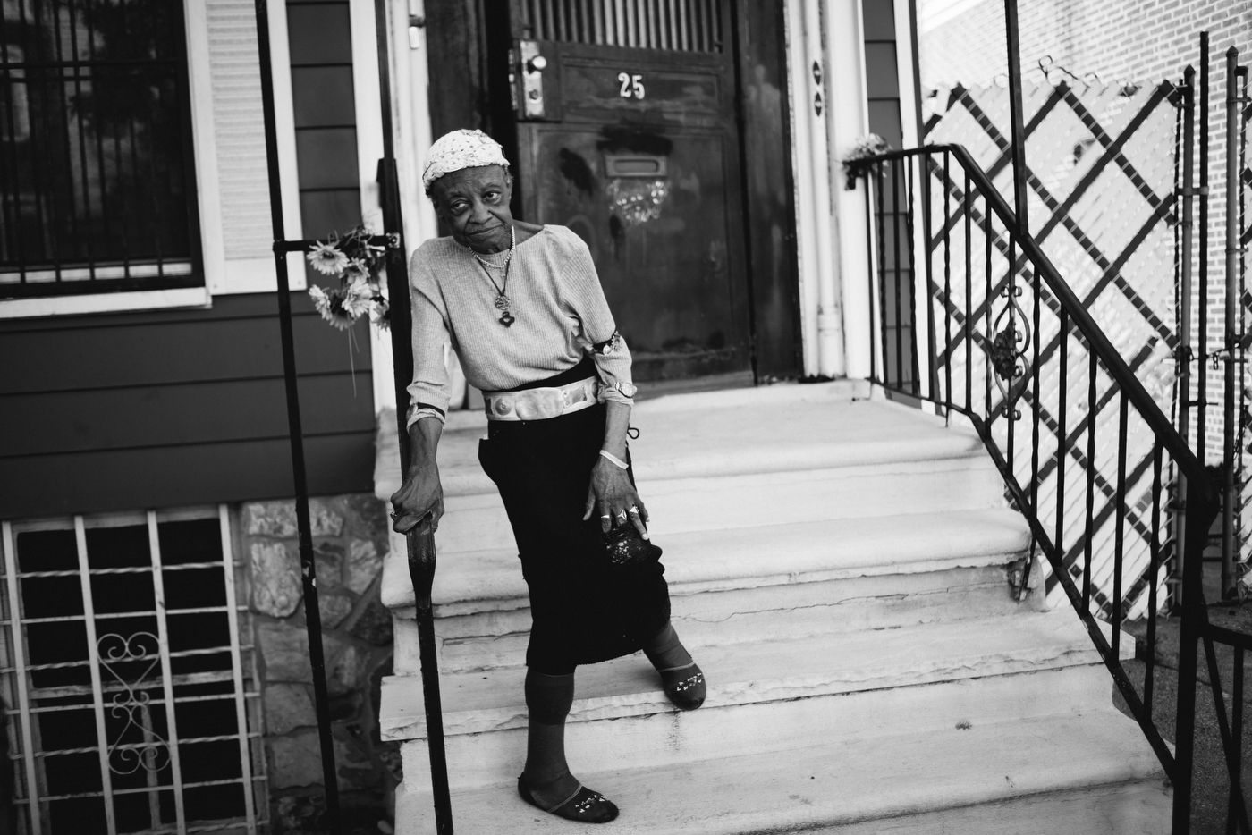 "Luzanna ""Miss Lucie"" Campbell, 90, has lived on Kossoth Place in Bushwick since she was 18 and has watched the neighborhood change. Now, all the German immigrants have moved away. After attending five different universities and trade school, Miss Lucie speaks (or tries) Spanish to many of the Puerto Ricans who pass her door."