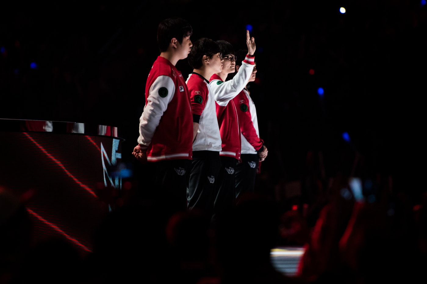 """Lee """"Faker"""" Sang-hyeok, second from right, likely the greatest player in the history of League of Legends, waves to the crowd ahead of his team's semifinal match."""