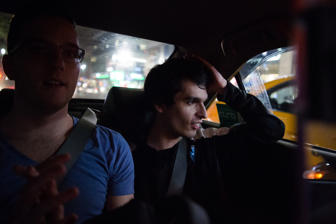 """Michael """"Veteran"""" Archer, head analyst for H2k-Gaming, watches passing traffic as he and other teammates take a cab from Madison Square Garden to a late team dinner at Benihana."""