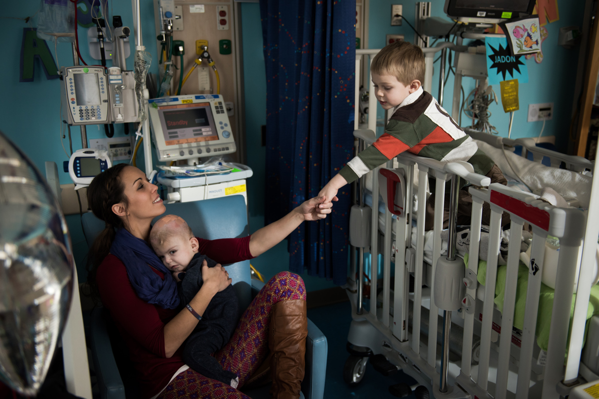 Nicole McDonald reaches out to hold the hand of her oldest son Aza as she holds one of her twins Anias at Montefiore Children's Hospital in The Bronx, New York, N.Y. on December 14, 2016.Credit: Mark Kauzlarich for CNN