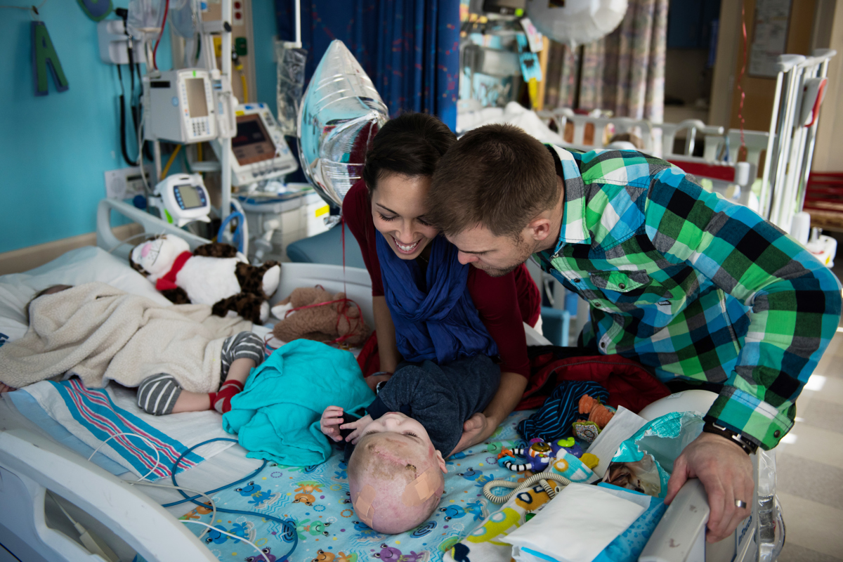 Nicole and Christian McDonald look at and play with their son Anias before the family leaves Montefiore Children's Hospital in The Bronx, New York, N.Y. on December 14, 2016.