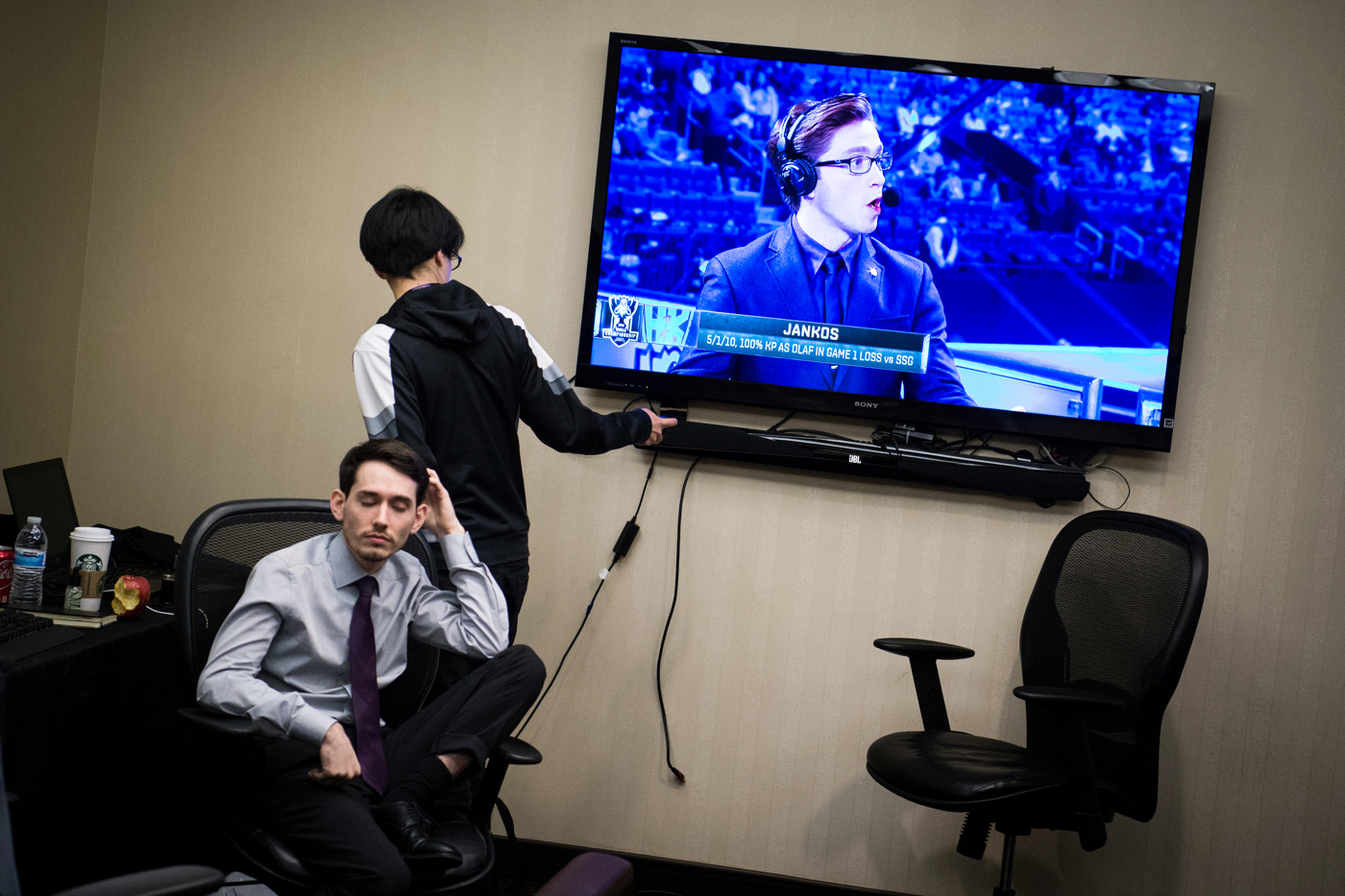 """H2k-Gaming team analyst Michael """"Veteran""""Archer tries to turn off the television recapping the team's loss as head coach Neil """"PR0LLY""""Hammad tries to gather his thoughts."""