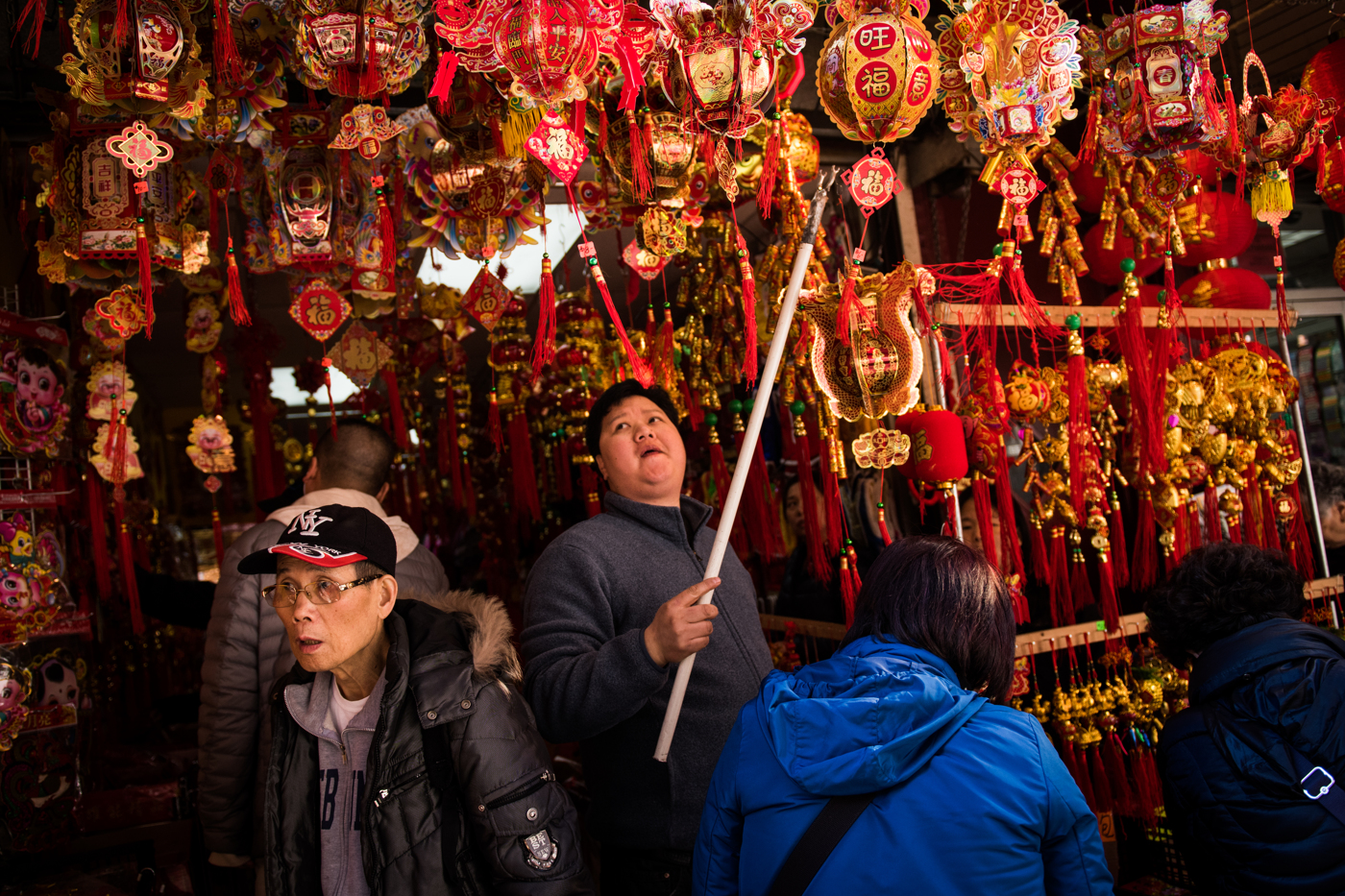A man moves lanterns around a store in preparation for Chinese New Year in the Chinatown neighborhood of Manhattan in New York, NY.