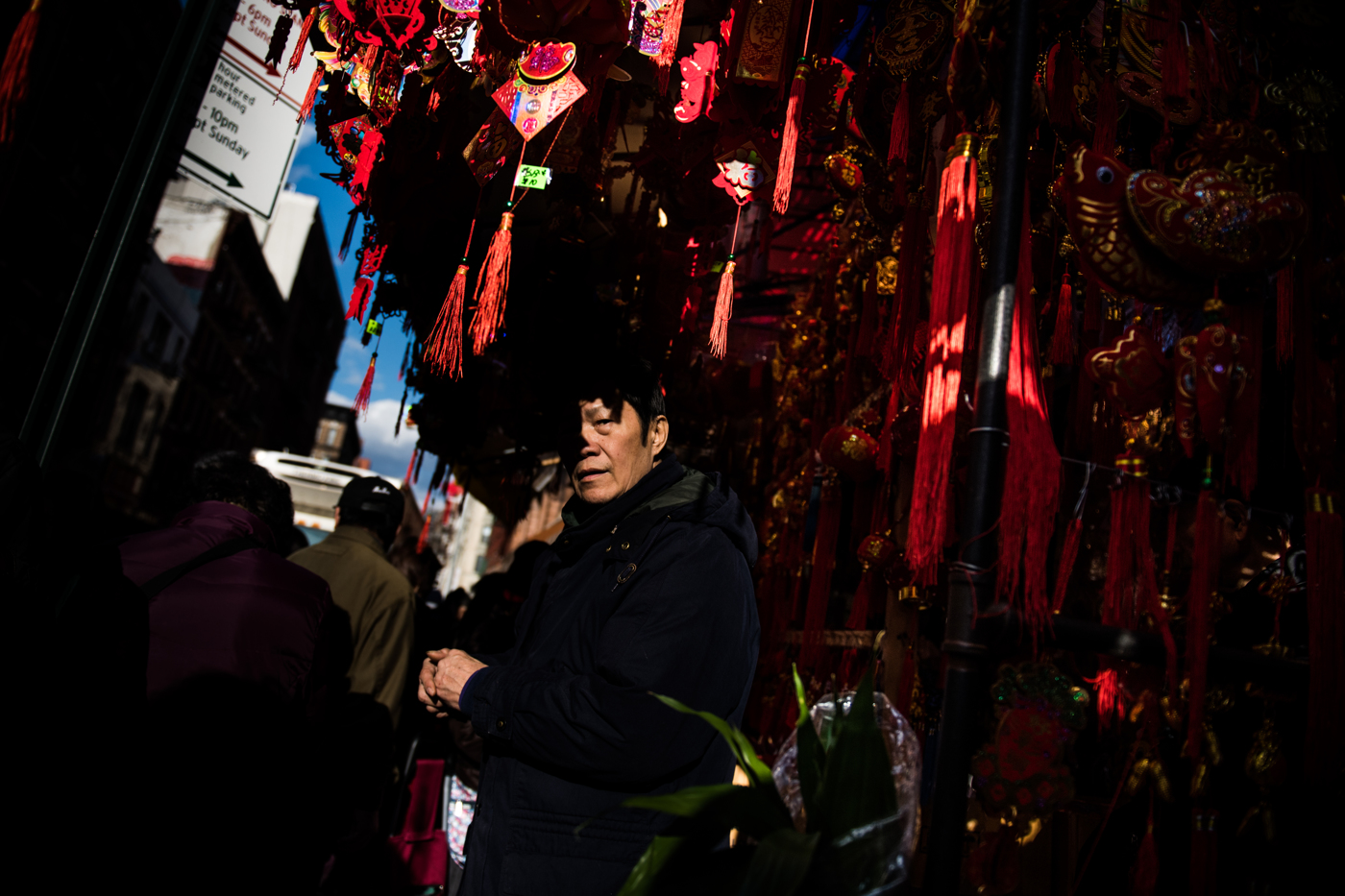 A man organizes merchandise at a store selling items in preparation for Chinese New Year in the Chinatown neighborhood of Manhattan in New York, NY.