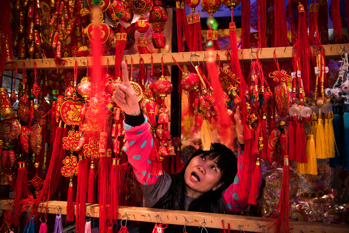 A worker points out different items while naming prices ahead of Chinese New Year in the Chinatown neighborhood of Manhattan in New York, NY.