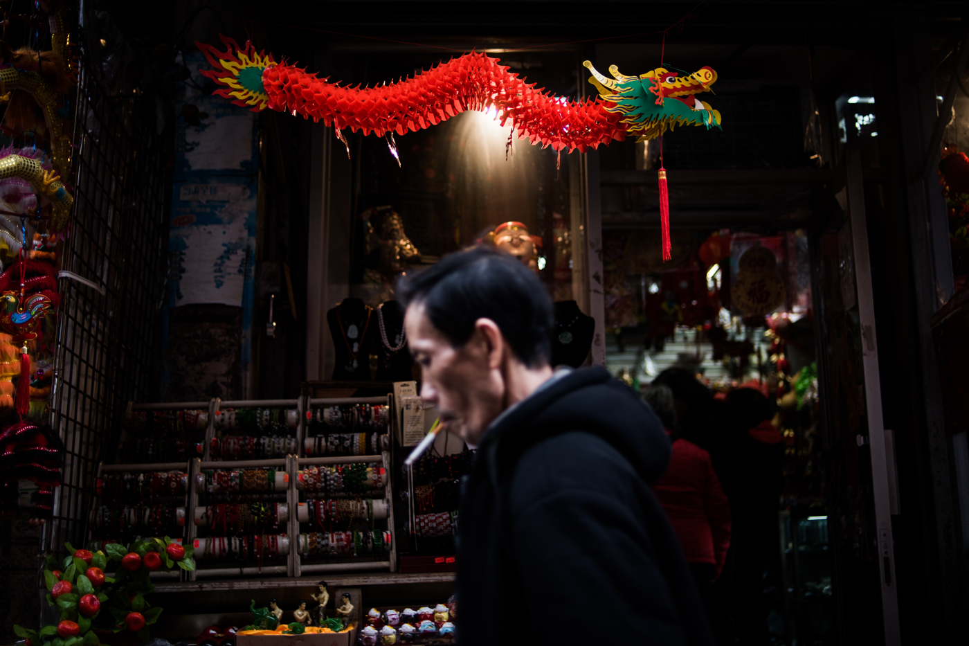 A dragon hangs outside a store in the Chinatown neighborhood of Manhattan in New York, NY.