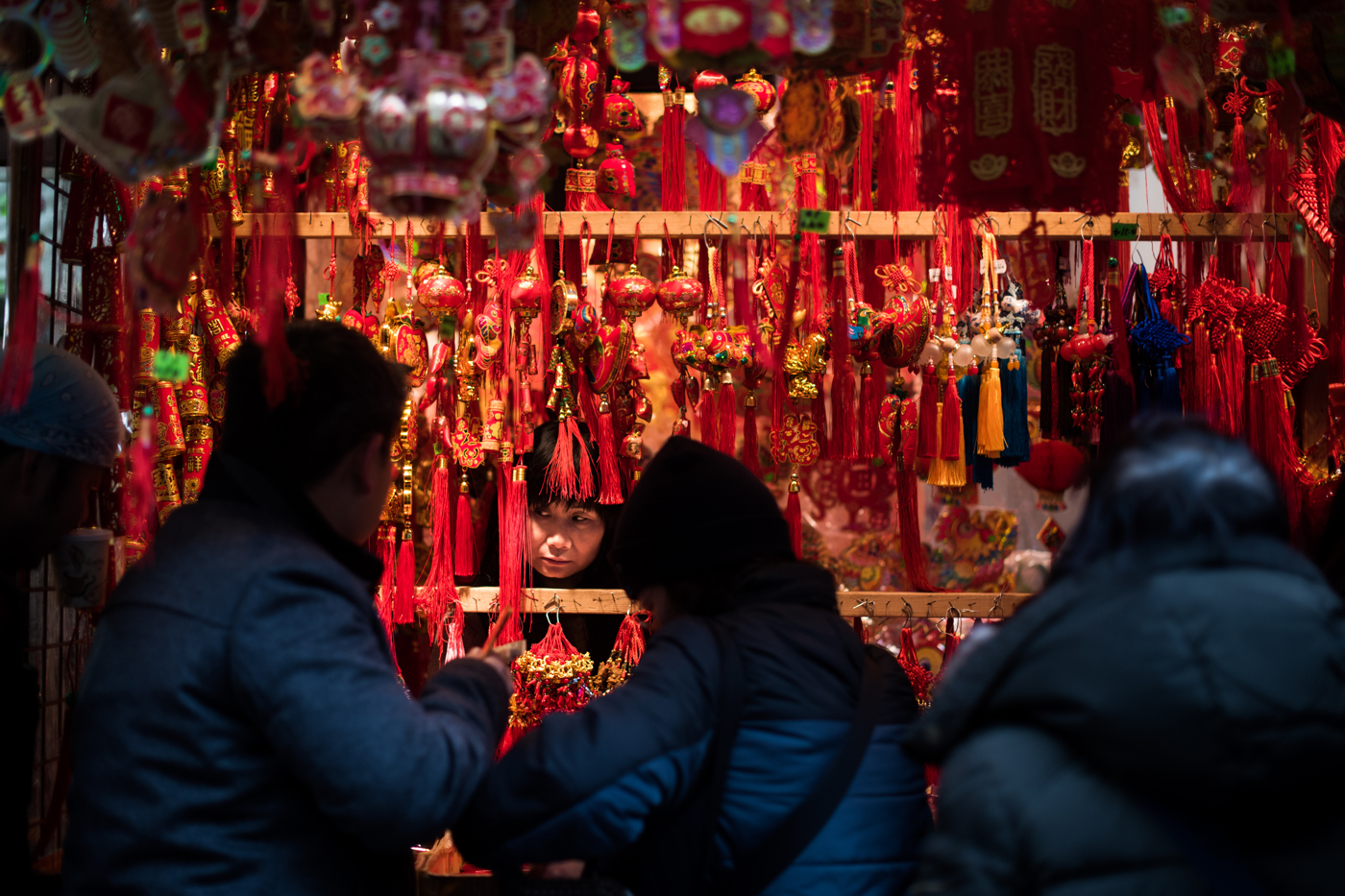 A woman sells items in preparation for Chinese New Year in the Chinatown neighborhood of Manhattan in New York, NY.