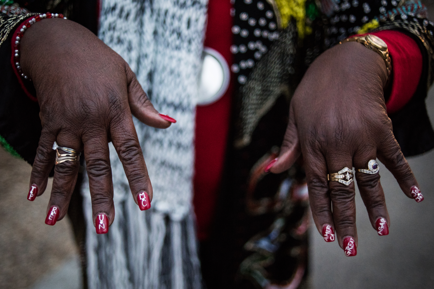 """Lucy Orlando, a supporter of then-President Elect Donald Trump shows off her painted nails that read """"TRUMP PENCE"""" and """"MAKE AMERICA GREAT AGAIN"""" before Trump's inauguration as the 45th President of the United States in Washington, D.C., on January 20, 2017. Credit: Mark Kauzlarich for CNN"""