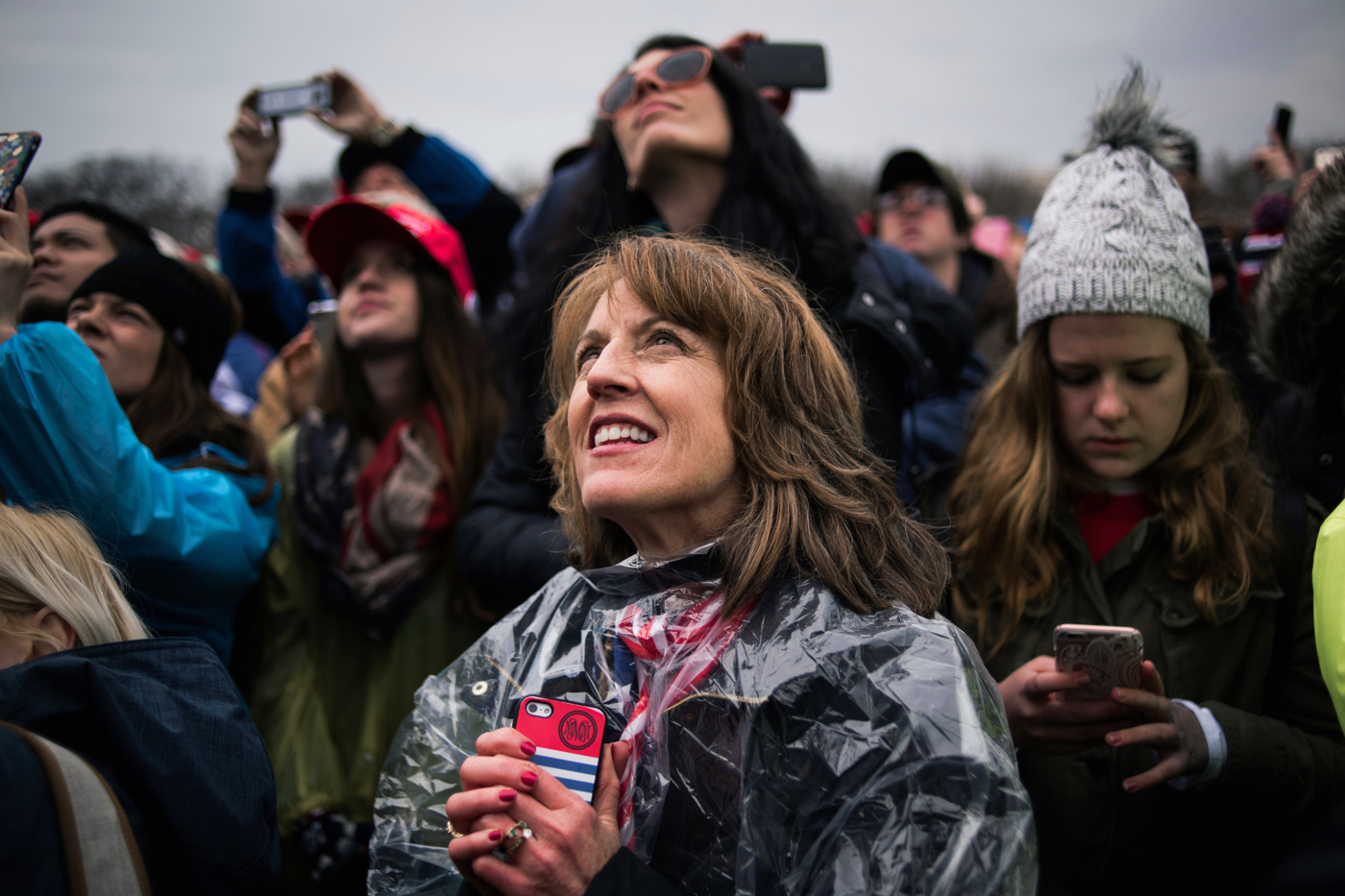 A woman looks up and recites the oath of office along with President Donald Trump's during his inauguration as the 45th President of the United States in Washington, D.C., on January 20, 2017. Credit: Mark Kauzlarich for CNN