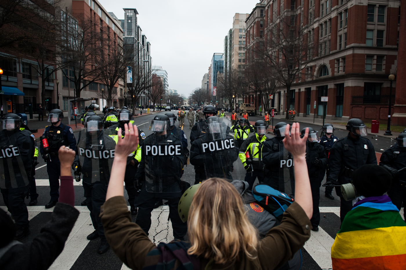 D.C. Metropolitan Police officers hold a line against protestors on the day of the President Donald Trump's inauguration as the 45th President of the United States in Washington, D.C., on January 20, 2017. Credit: Mark Kauzlarich for CNN