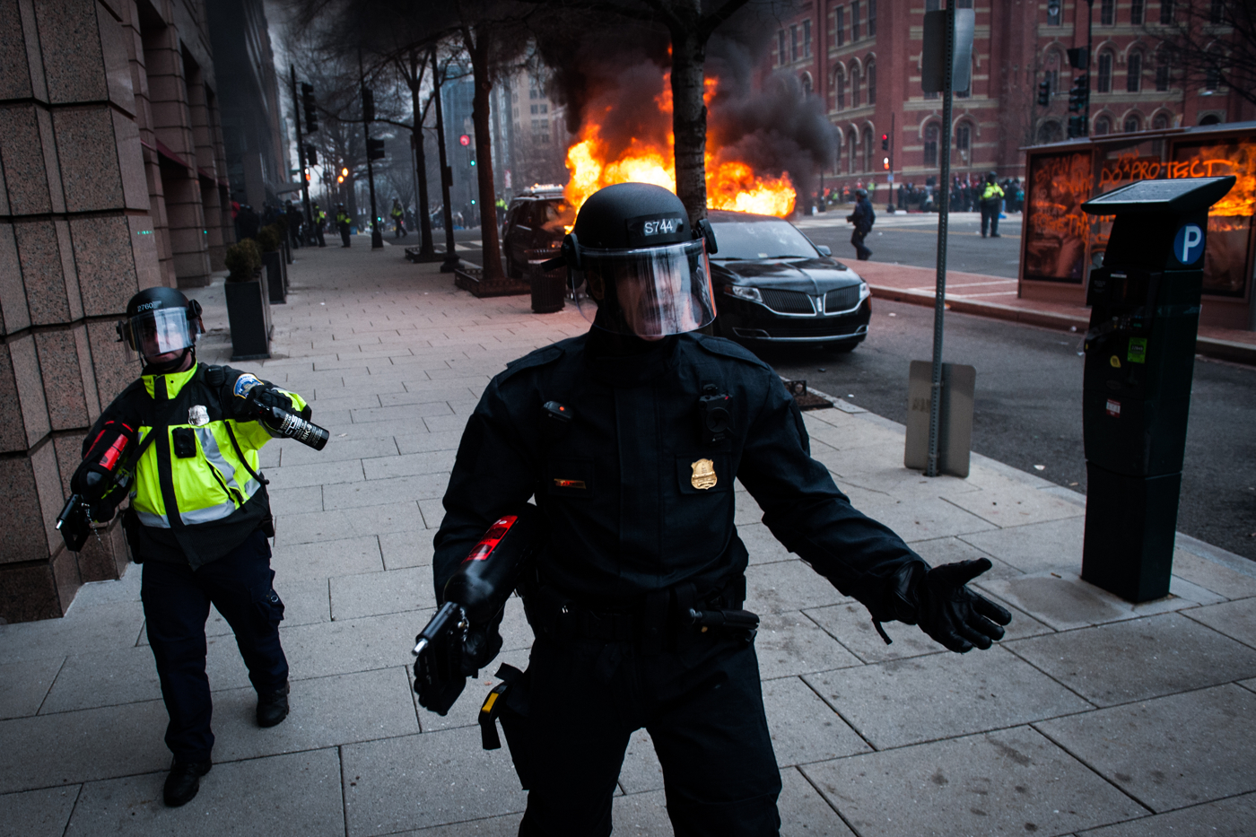 D.C Metropolitan Police advance on the crowd after a group set fire to a limousine during a protest of Donald Trump's inauguration as the 45th President of the United States in Washington, D.C., on January 20, 2017. Credit: Mark Kauzlarich for CNN