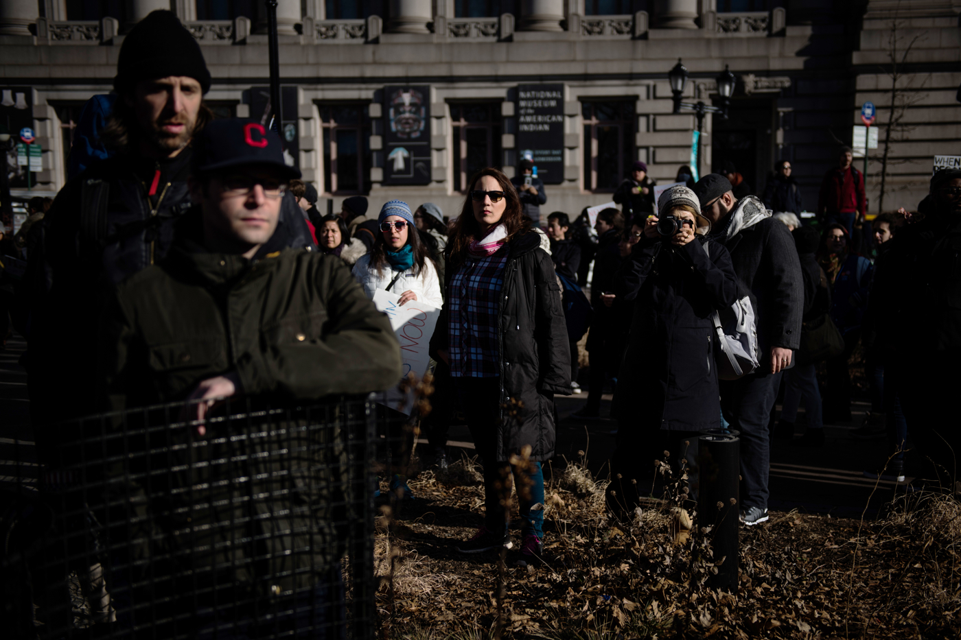 People stand as they wait for a march to begin from Battery Park to Federal Plaza in the Manhattan borough of New York, NY on Saturday, January 29, 2017. Credit: Mark Kauzlarich for CNN