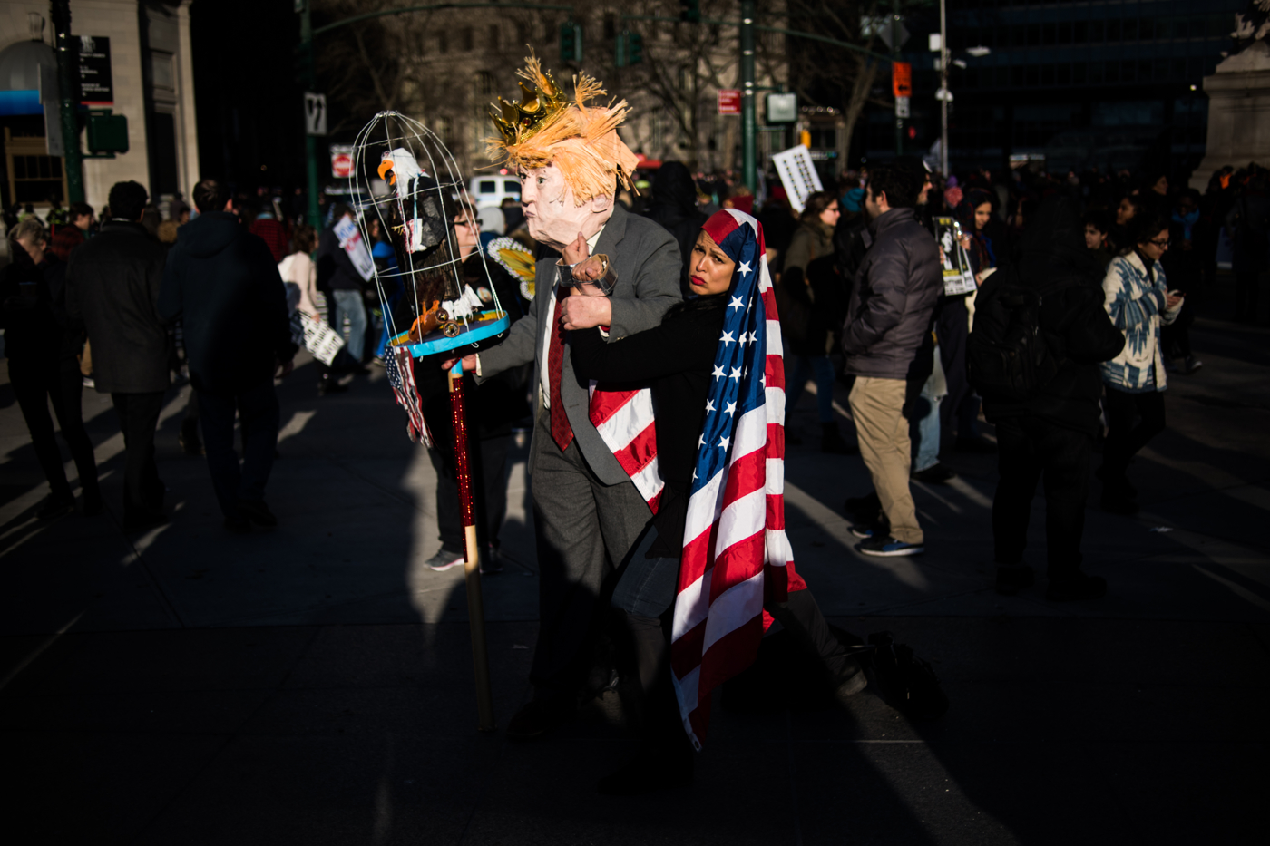 Protestors dressed as President Donald Trump and a shackled Muslim immigrant stand in Battery Park, New York, NY on Saturday, January 29, 2017. Credit: Mark Kauzlarich for CNN