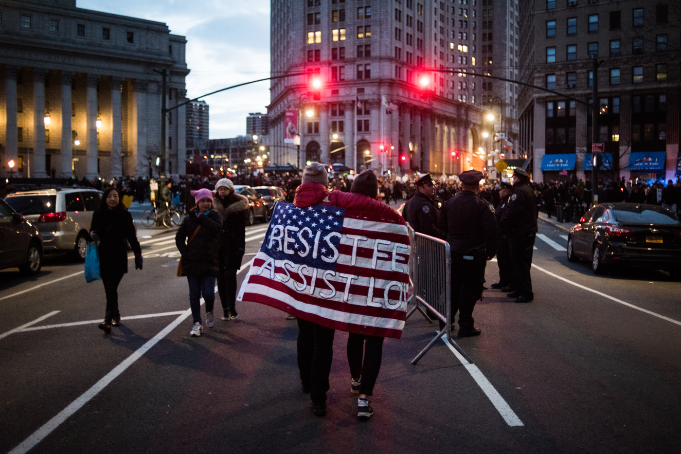 "Protestors carrying a flag reading ""Resist Fear, Assist Love"" leave Federal Plaza after marching from Battery Park in support of refugees in New York, NY on Saturday, January 29, 2017. Credit: Mark Kauzlarich for CNN"