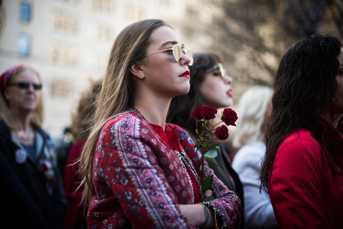 A woman stands in the crowd and listens to speakers during an International Women's Day rally and march in New York, NY on March 8, 2017. CREDIT: Mark Kauzlarich for CNN