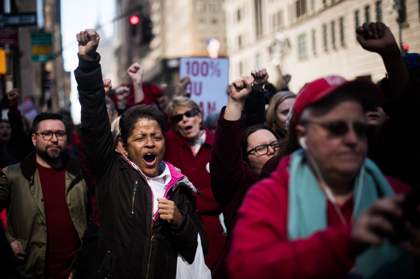 Gloria Brown, 55, cheers during an International Women's Day rally and march in New York, NY on March 8, 2017. Brown missed a little bit of work today to come out to the protests and said: