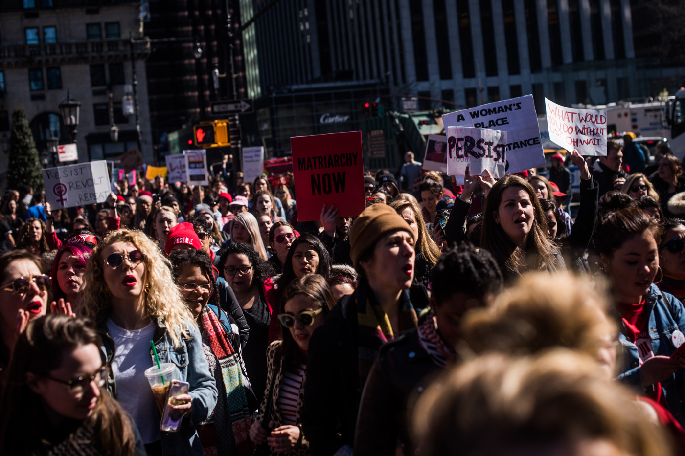 Demonstrators march along 59th Street during an International Women's Day rally and march in New York, NY on March 8, 2017. CREDIT: Mark Kauzlarich for CNN