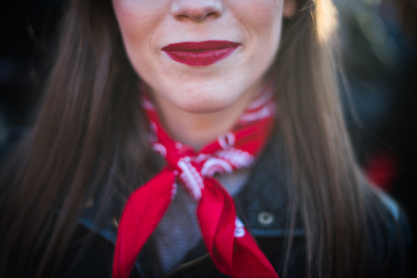 Mary Koerner wears red lipstick and a bandana in solidarity with women around the world during an International Women's Day rally and march at Washington Square Park in New York, NY on March 8, 2017. CREDIT: Mark Kauzlarich for CNN