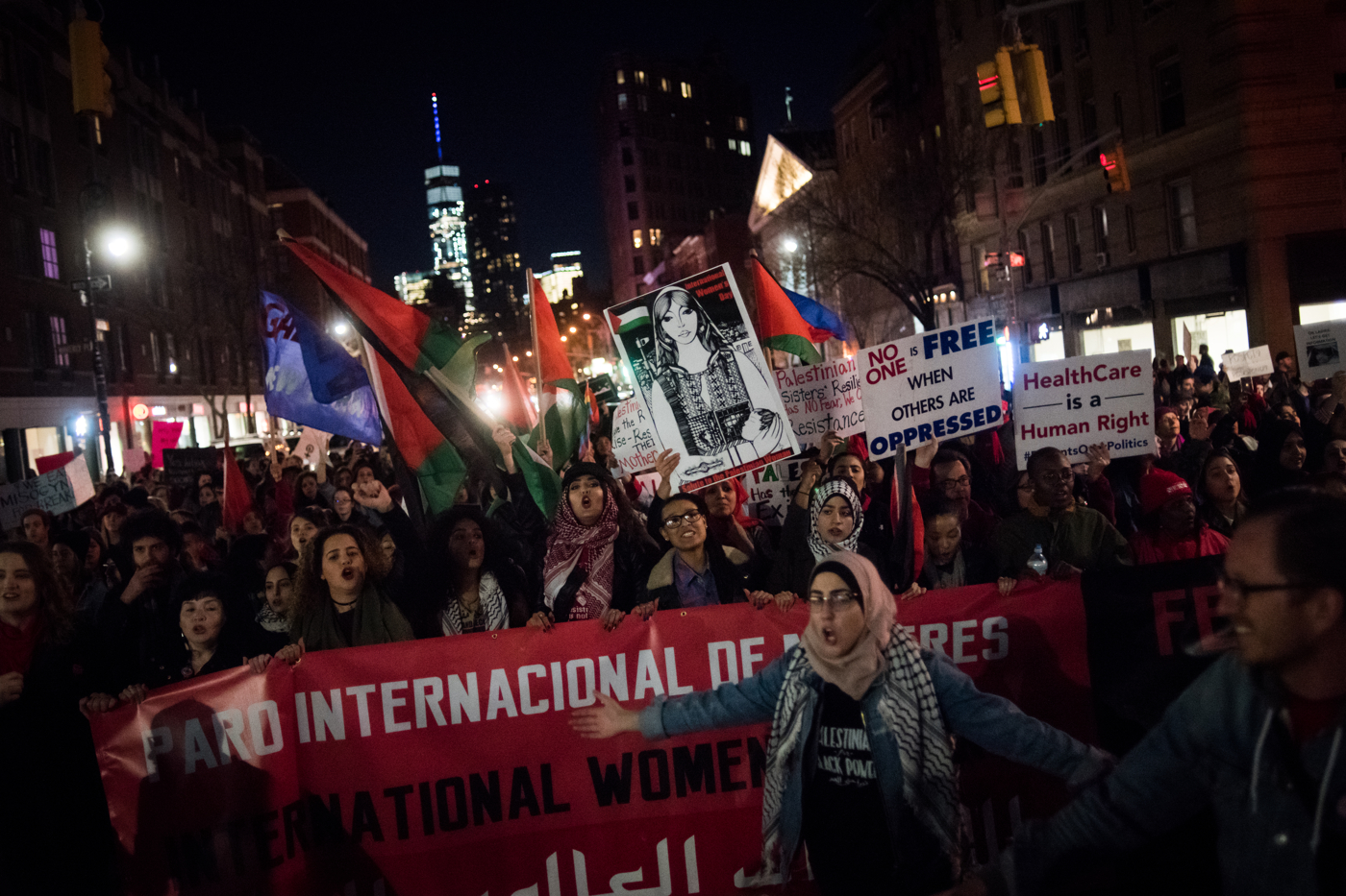 People march down the street after an International Women's Day rally at nearby Washington Square Park in New York, NY on March 8, 2017. CREDIT: Mark Kauzlarich for CNN