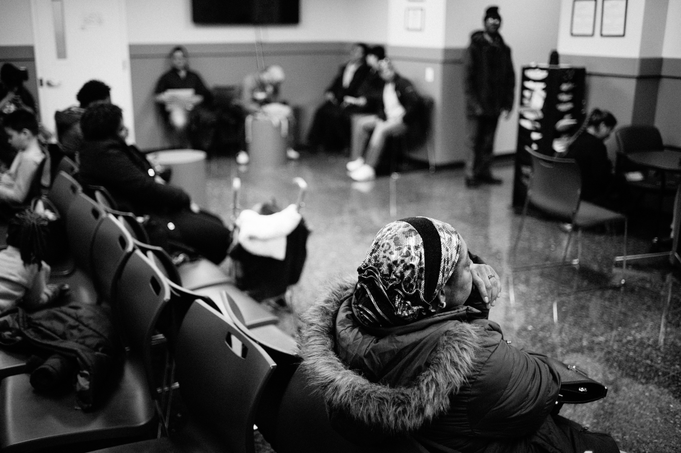 People sit in the waiting room at Catholic Charities Community Services during their walk-in hours for immigration-related legal services in New York, NY on March 9, 2017. CREDIT: Mark Kauzlarich for CNN