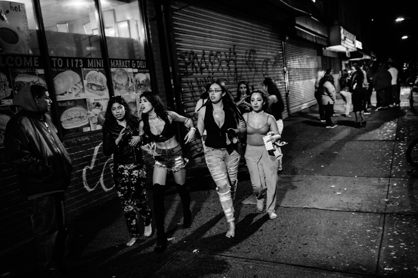Women flee what many people thought was a shooting but ended up being a violent fight outside a bar along Broadway in the Bushwick neighborhood of Brooklyn, NY.