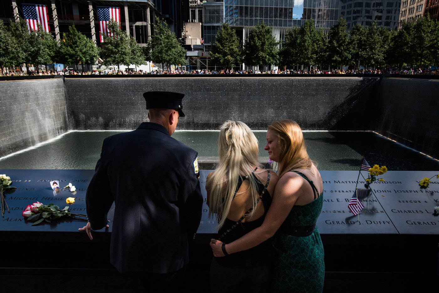 A woman comforts her sister as they gather at the National September 11 Memorial in Manhattan, New York, September 11, 2016, on the 15th anniversary of the terrorist attacks on September 11, 2001.
