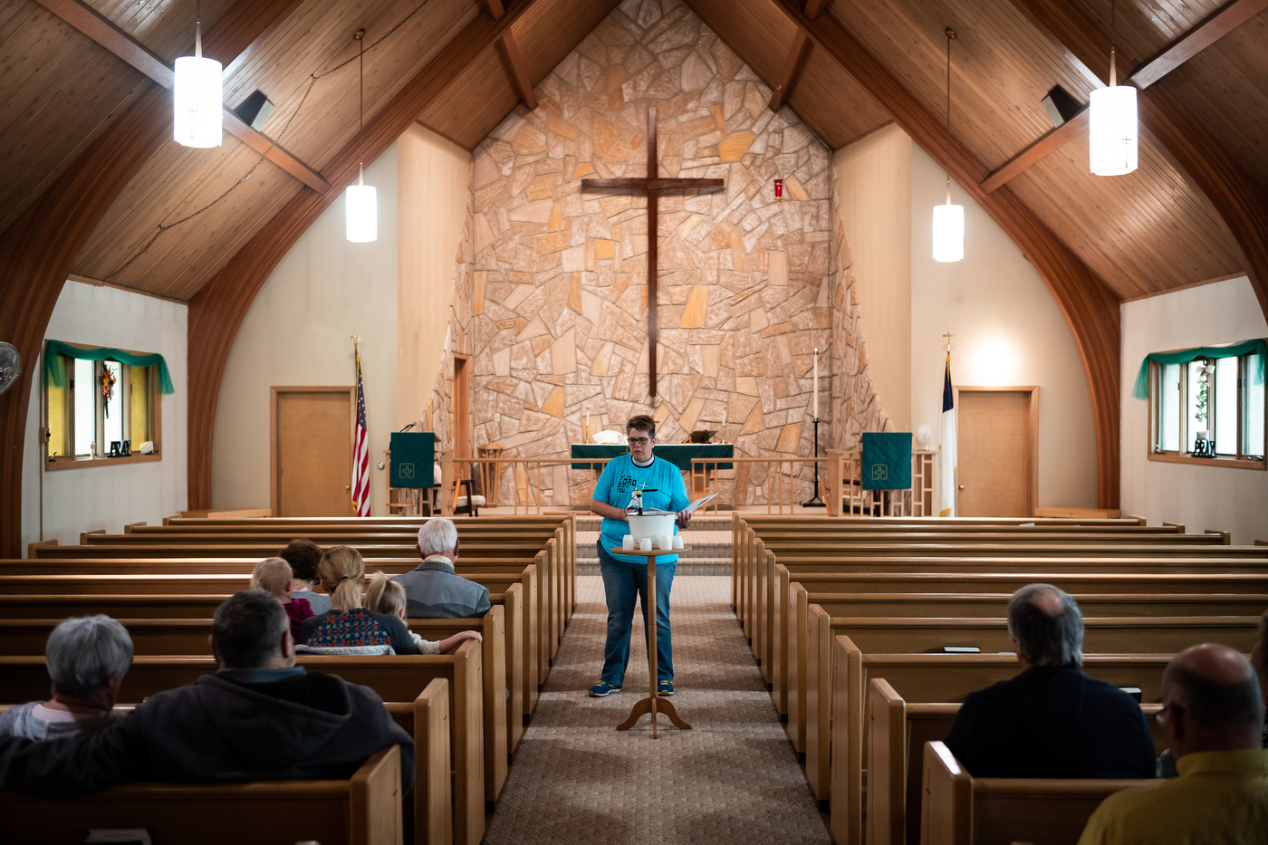 Pastor Tera Kossow leads worship at American Lutheran Church, an ELCA church, in Bison, SD.