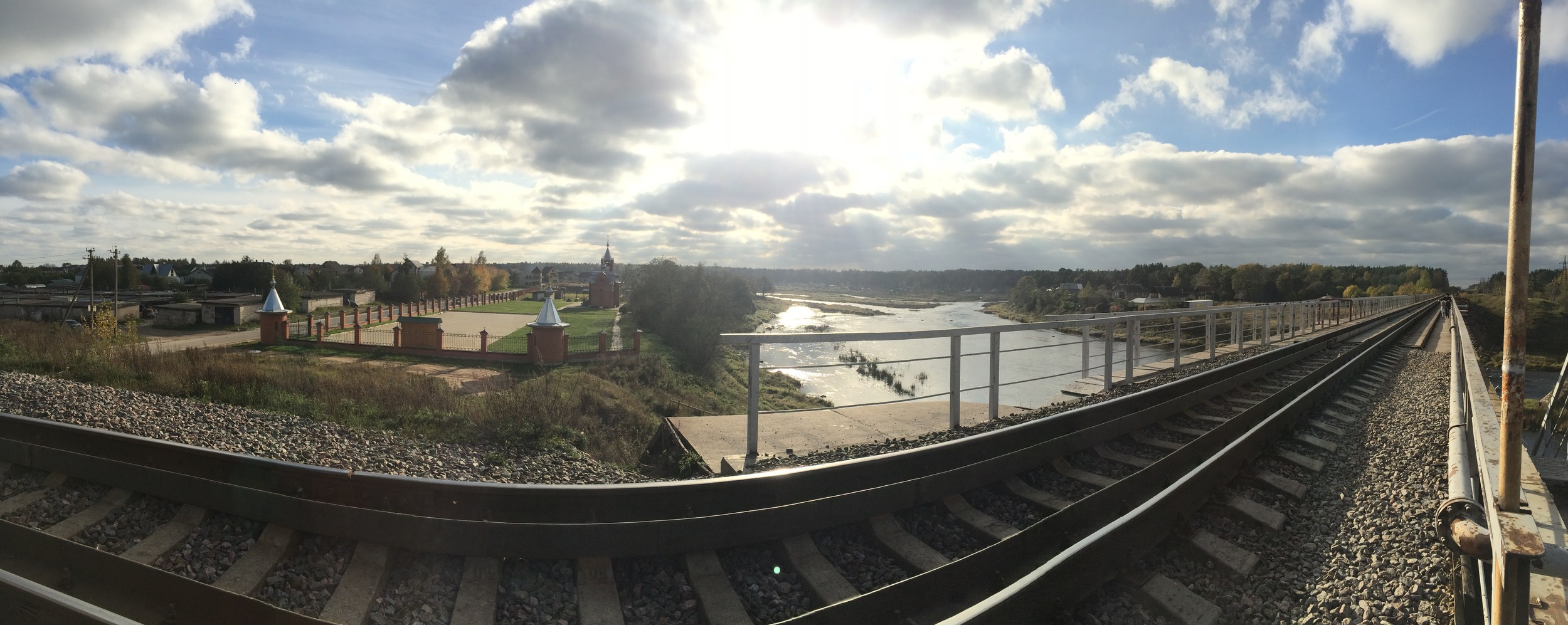 Panorama of the train tracks crossing the Luga River in Kingisepp.
