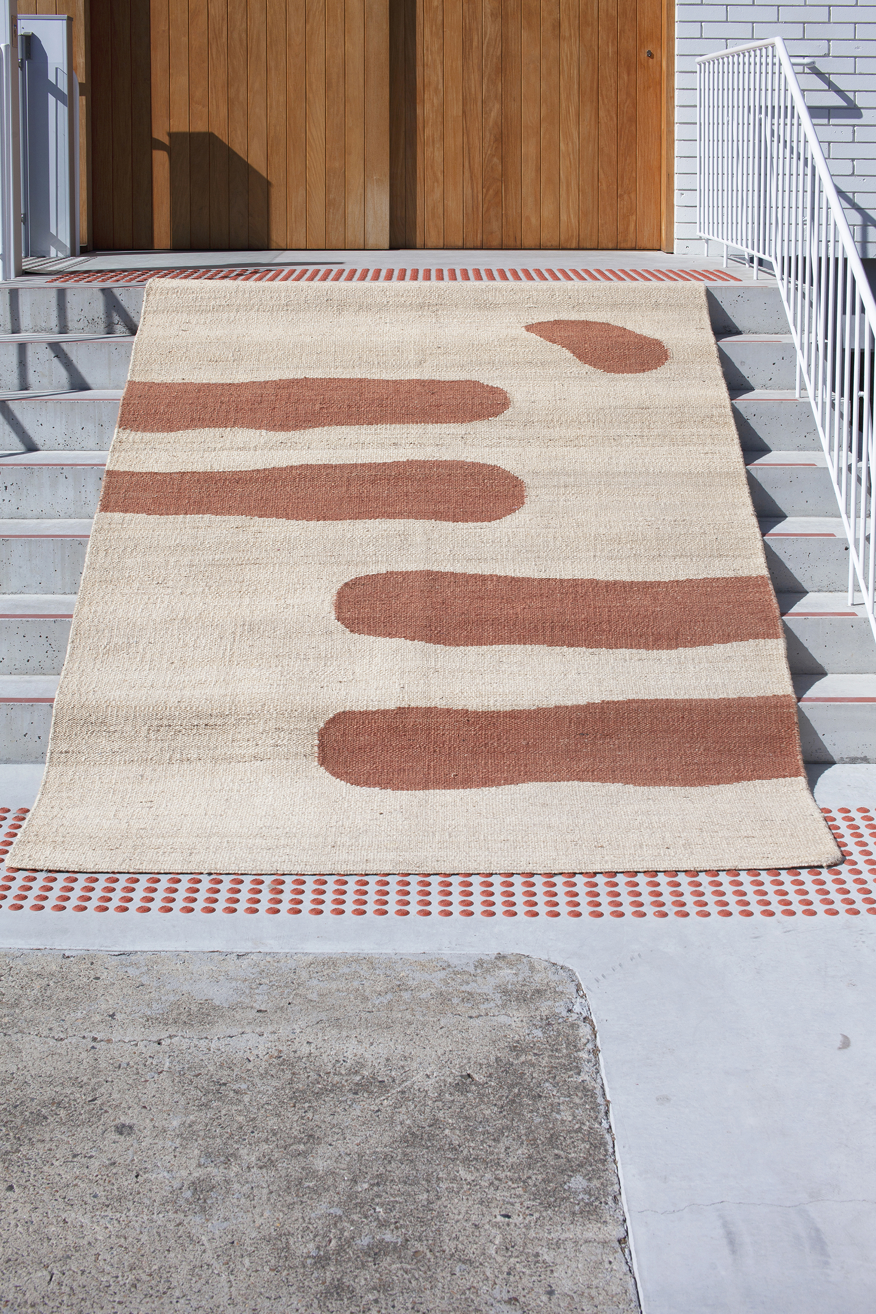 Rug • Woven Reed Natural / Clay Jute