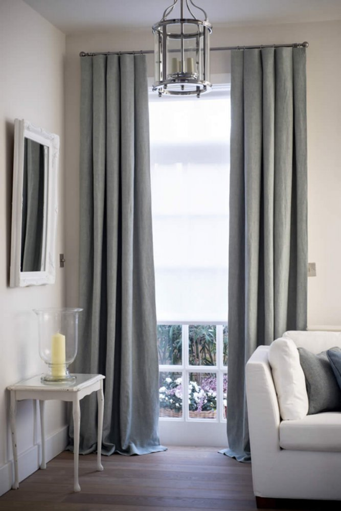 Contemporary inverted pleat linen curtains on a feature rod mix nicely with the more traditional elements of the room. Photo: Pret A Vivre
